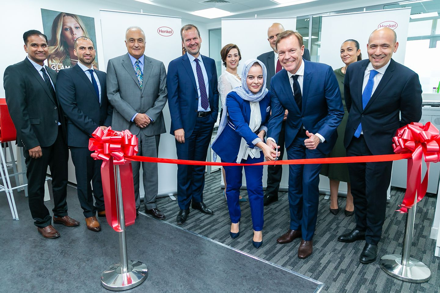 Jens-Martin Schwärzler, Executive Vice President Beauty Care (third from right) and Olfa Aouida, Head of R&D MEA, Beauty Care (sixth from left) during the ribbon cutting.
